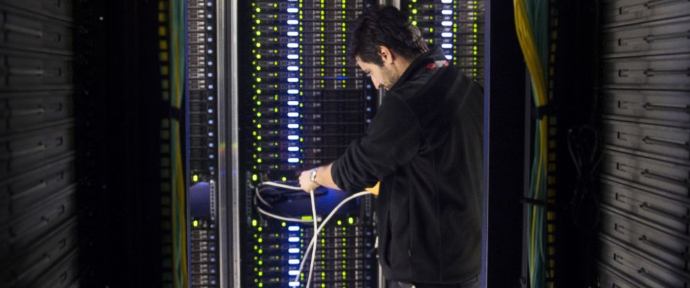 PHOTO: A data center employee checks servers in Pantin, France on July 21, 2014.