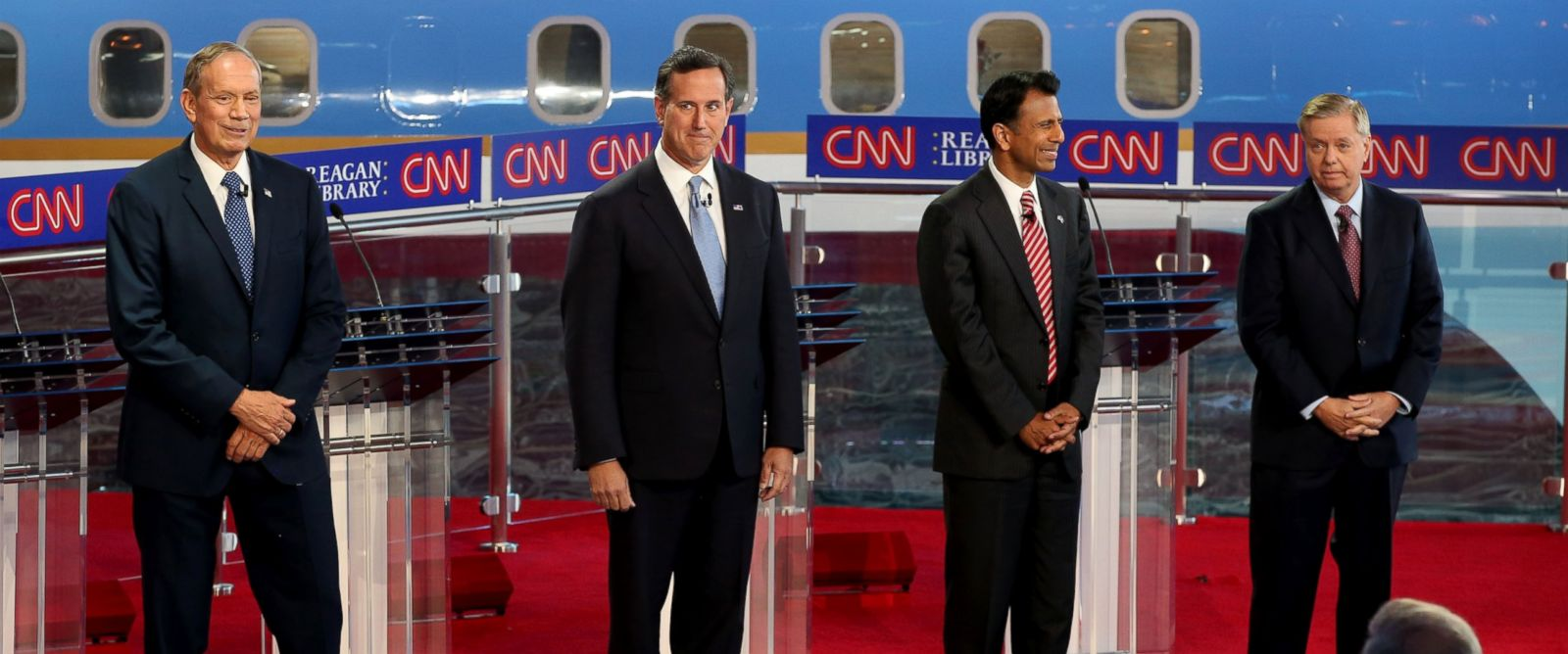 PHOTO: Republican presidential candidates, George Pataki, Rick Santorum, Louisiana Gov. Bobby Jindal and Senator Lindsey Graham stand onstage during the presidential debates at the Reagan Library on Sept.16, 2015 in Simi Valley, Calif.