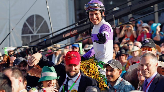 PHOTO: Jockey Mario Gutierrez celebrates in the winners circle after riding I'll Have Another to win the 137th Preakness Stakes at Pimlico Race Course.