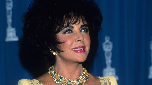 PHOTO: Elizabeth Taylor poses with her Oscar at the 65th Annual Academy Awards at the Shrine Auditorium on March 29, 1993 in Los Angeles, California.