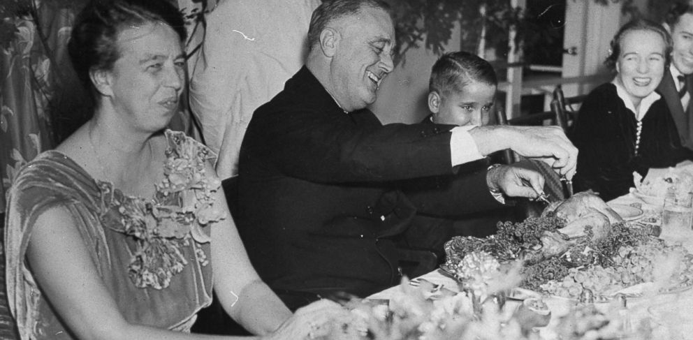PHOTO: President Franklin D. Roosevelt and his family, smiling and laughing during Thanksgiving dinner., 1937.