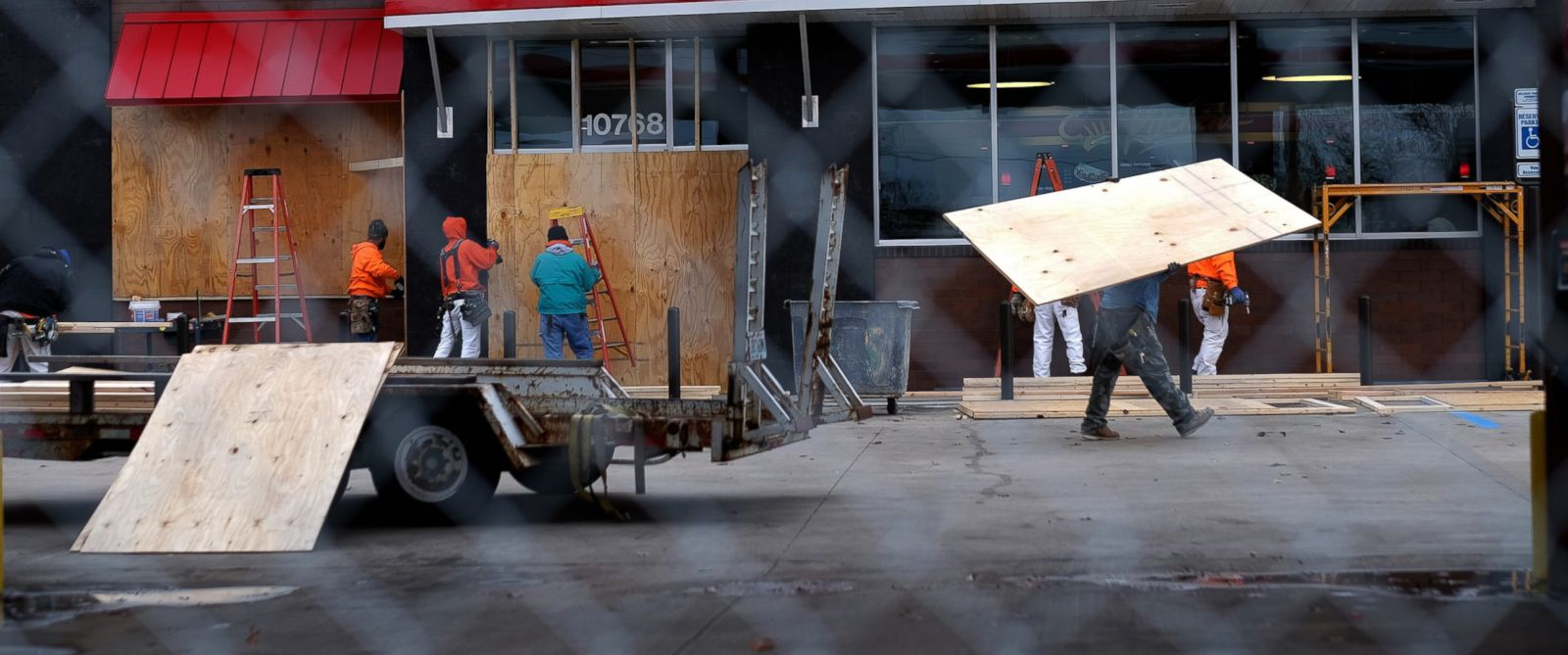 PHOTO: Workers board up windows and install fencing around a gas station in Ferguson Mo., Nov. 24, 2014 in anticipation of an announcement on the grand jury decision on whether to indict a white police officer for the fatal shooting of a black teenager.