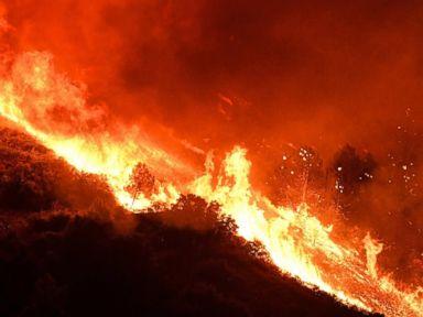 PHOTO: Flames climb toward Loma Prieta peak in Californias Santa Cruz Mountains, Sept. 26, 2016.