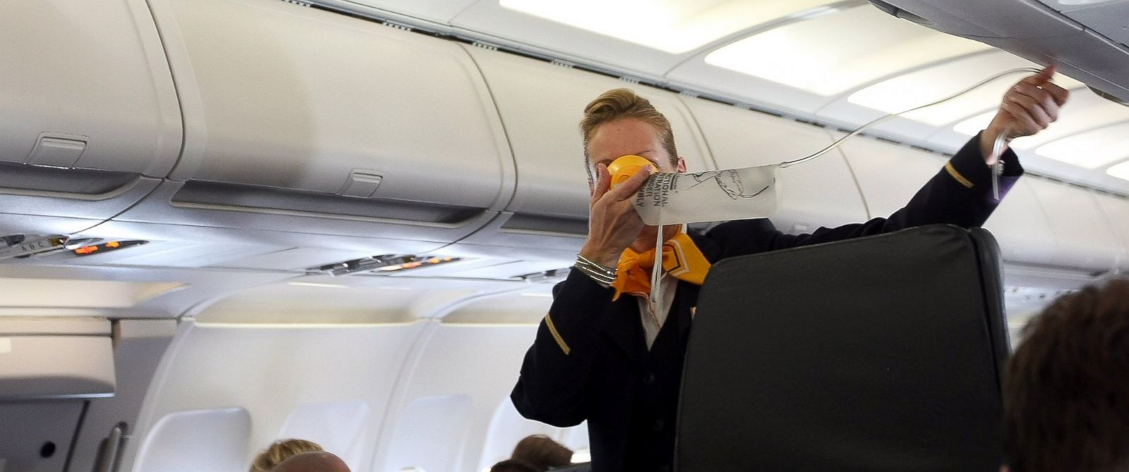 PHOTO: A Lufthansa flight attendant instructs passengers on the use of their oxygen masks on a flight to Frankfurt on September 14, 2012 at Tegel airport in Berlin, Germany.
