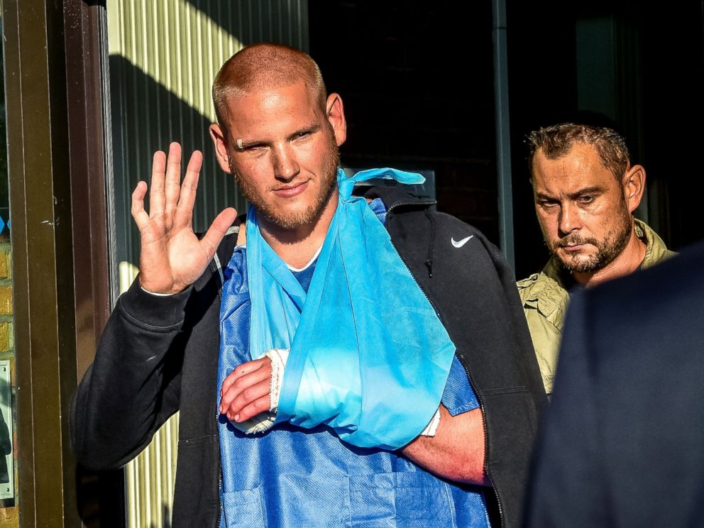 PHOTO: Off-duty US Air Force Spencer Stone (L), one of the men to overpower the gunman who opened fire with an assault rifle on a high-speed train, gestures as he leaves the hospital, Aug. 22, 2015, in Lesquin, France.