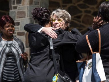 PHOTO: Mourners embrace as they wait in line outside Vaughn Greene Funeral Services for the wake of Freddie Gray, April 26, 2015 in Baltimore, Maryland.