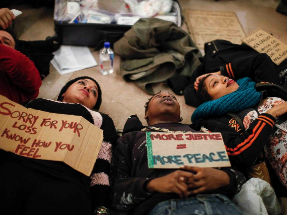 PHOTO: People lie down during a demonstration against police violence in Grand Central Station on Dec. 22, 2014 in New York City.
