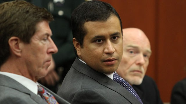 PHOTO: George Zimmerman, center, sits during his bond hearing with his attorney Mark OMara, left, in a Seminole County courtroom on June 29, 2012 in Sanford, Fl.