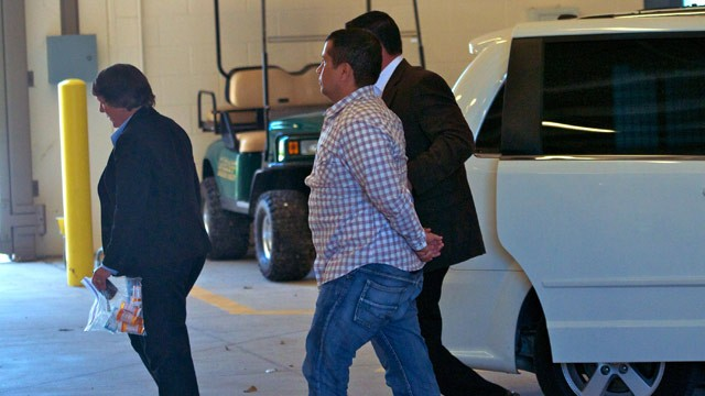PHOTO: George Zimmerman (C) is escorted by police as he returns to Seminole County Jail after having his bond revoked because of allegedly misleading the court about his finances June 3, 2012 in Sanford, Florida.