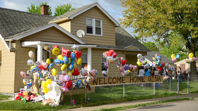 PHOTO: The family house of Gina DeJesus, one of the three women which were held captive for a decade, is decorated by well wishers May 7, 2013 in Clevel