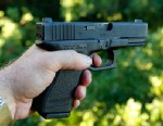 PHOTO: A Glock 23, 40 caliber handgun is held on July 23, 2012 in Provo, Utah.