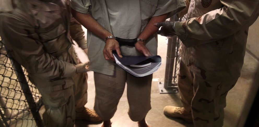 PHOTO: U.S. Navy guards escort a detainee in the Guantanamo Bay detention center, March 30, 2010, in Guantanamo Bay, Cuba.