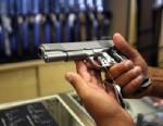 PHOTO: A man chooses a gun at a gun shop in Glendale, California.