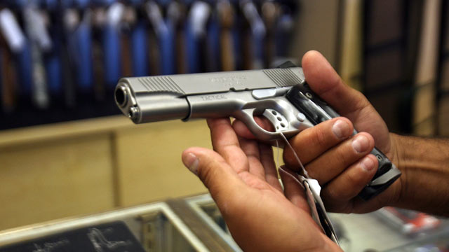 PHOTO: A man chooses a gun at a gun shop in Glendale, California.