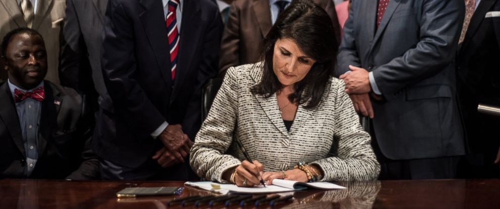 PHOTO: South Carolina Gov. Nikki Haley signs a bill to remove the Confederate battle flag from the state house grounds July 9, 2015 in Columbia, S.C.