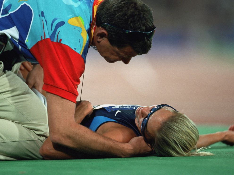 PHOTO: Suzy Favor-Hamilton lays on the track from over exertion after the womens 1500 meter race during the Olympics at the Olympic Stadium in Sydney, on Sept. 30, 2000.