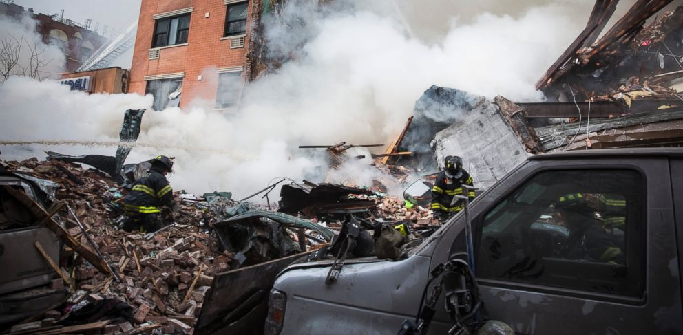 PHOTO:  Heavy smoke pours from the debris as the Fire Department of New York responds to a 5-alarm fire and building collapse at 1646 Park Ave in the Harlem neighborhood of Manhattan March 12, 2014 in New York City.