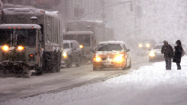 PHOTO: Plows and taxis mingle on the street during a snowstorm in this Feb. 12, 2006 file photo in New York City.