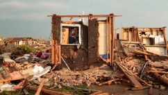 PHOTO: Dana Ulepich searches inside a room left standing at the back of her house destroyed after a powerful tornado of at least EF4 strength ripped through the area on May 20, 2013 in Moore, Oklahoma.