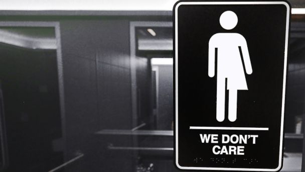 PHOTO: Gender neutral signs are posted in the 21C Museum Hotel public restrooms on May 10, 2016 in Durham, North Carolina.