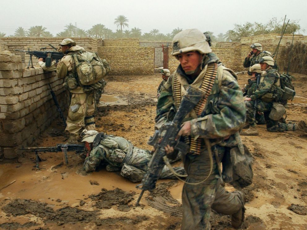 PHOTO: US marines from the 2nd Battalion 8th Regiment take their position in the southern city of Nasiriyah, Iraq, March 26, 2003, during an evacuation of the population living in the area where there was an Iraqi attack the day before.