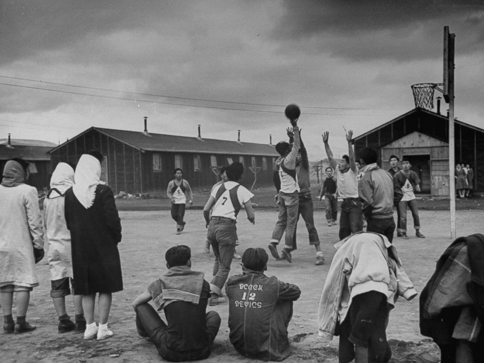 PHOTO: Young men play basketball at a Japanese internment camp in Tule Lake, Calif. in 1944.
