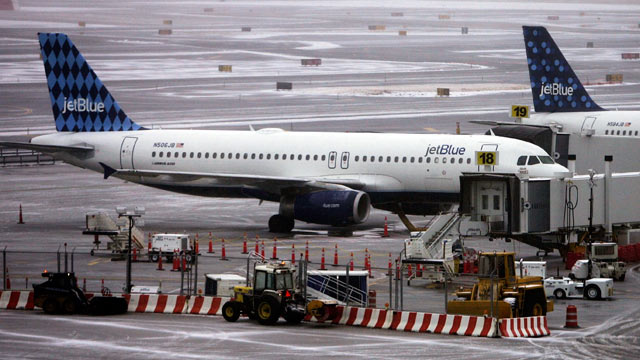 PHOTO: Jet Blue planes sit on the tarmac outside the Jet Blue terminal at John F. Kennedy Airport in New York City, in this file photo.