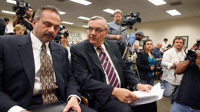 PHOTO: Joe Arpaio, right, confers with his lead investigator Michael Zullo during a news conference announcing the findings of his investigation into the authenticity of President Barack Obama's birth certificate.