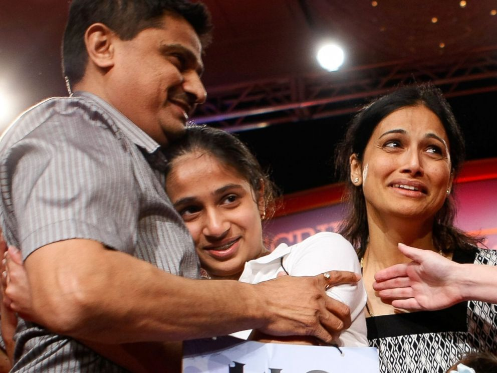 PHOTO: Kavya Shivashankar of Olathe, Kansas, receives a hug from her parents Mirle and Sandy after she won the 2009 Scripps National Spelling Bee competition May 28, 2009 in Washington, DC.