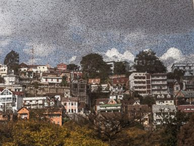 PHOTO: A swarm of locusts invades the center of Madagascars capitol on Aug. 28, 2014.
