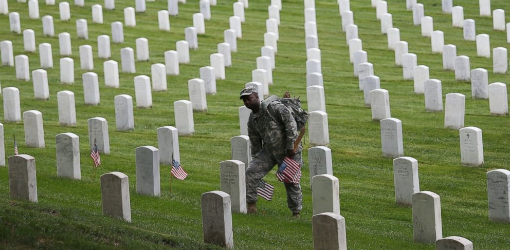 PHOTO: Members of the 3rd U.S. Infantry Regiment place American flags at the graves of U.S. soldiers buried at Arlington National Cemetery, in preparation for Memorial Day, in Arlington, Va., May 21, 2015.