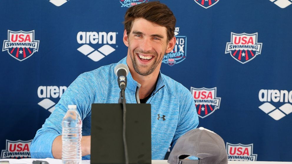 PHOTO: Michael Phelps speaks at a press conference at the Skyline Aquatic Center on April 23, 2014 in Mesa, Ariz.