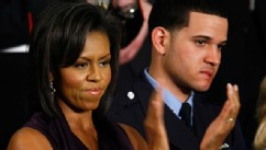 PHOTO: Michelle Obama applauds her husband, President Barack Obama, while he addresses a joint meeting of Congress as Philadelphia Police Officer Richard DeCoatsworth, right, stands by her, Feb. 24, 2009, at the U.S. Capitol in Washington, DC.