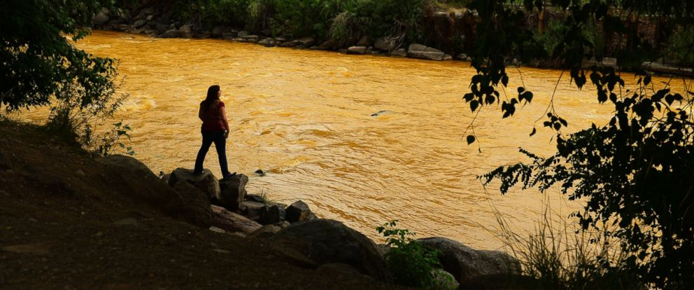 PHOTO: Kalyn Green of Durango, Colo. stands on the edge of the Animas River, Aug. 6, 2015.