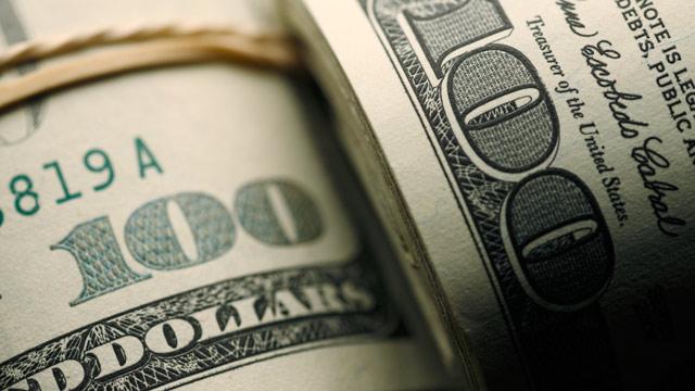 PHOTO: Rolls of $100 dollar bills