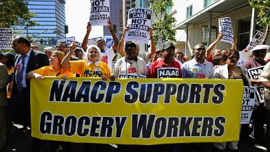 PHOTO: NAACP members participating in the NAACP's 102nd annual national convention at the Los Angeles Convention Center join labor march and a rally in front of the Ralphs grocery store on July 27, 2011 in Los Angeles, California.