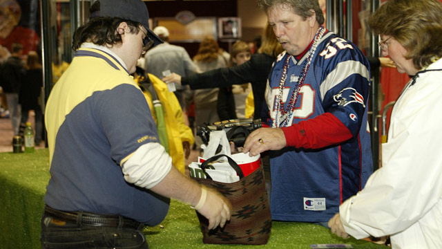 PHOTO: A New England Patriots fan entering the NFL experience goes through security screening at the Ernest N. Morial Convention Center in New Orleans, La.
