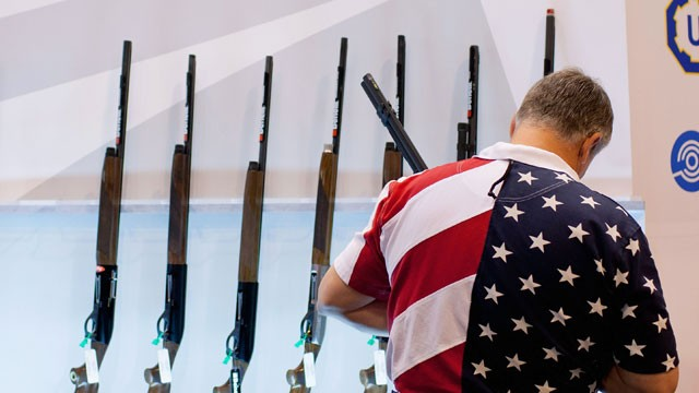 PHOTO: Chris Patrie looks at the Benelli display of shotguns in this file photo from the NRA Annual Meetings and Exhibits on April 13, 2012 at the America's Center in St. Louis, Missouri.