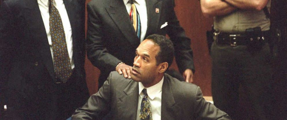 PHOTO: Defense attorneys Robert Shapiro and Johnnie Cochran stand behind O.J. Simpson in court, Jan. 5, 1995.