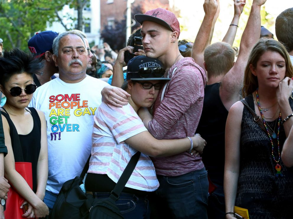 PHOTO: People gather outside of the Stonewall Inn in New York during a vigil for the victims of a massacre at a gay nightclub in Orlando, June 12, 2016.