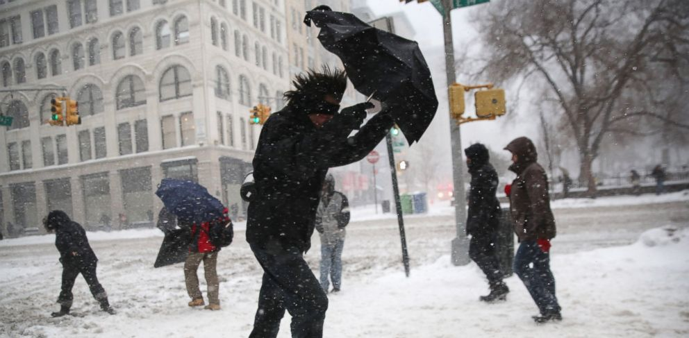 PHOTO: A man struggles with his umbrella while walking through the snow on Feb. 13, 2014 in New York City.
