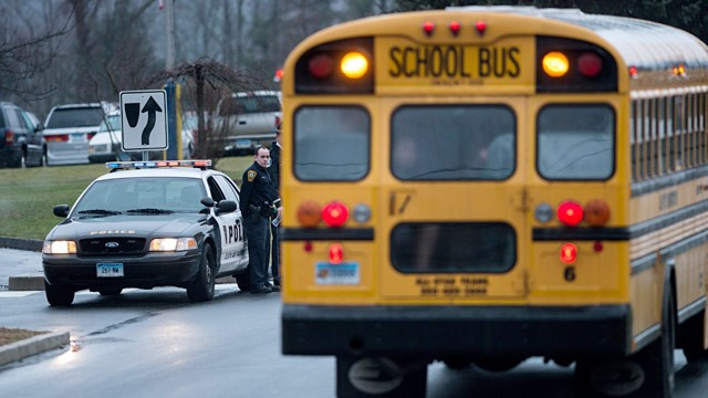 PHOTO: Police watch school bus