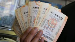 PHOTO: A customer holds $140 worth of Powerball tickets that he just purchased on May 17, 2013 in San Francisco, Calif.