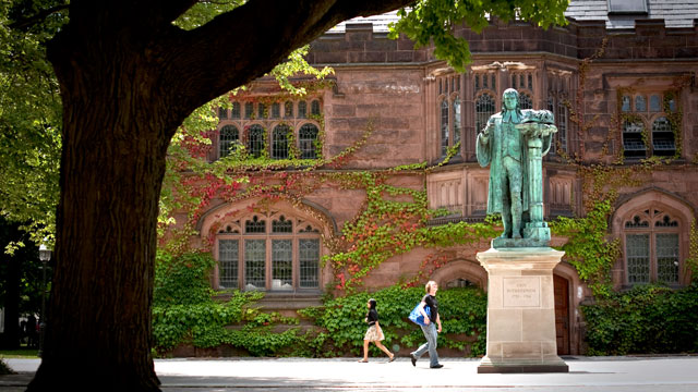 PHOTO: Pedestrians walk past a statue of former Princeton University president John Witherspoon near the East Pyne building on the schools campus in Princeton, N.J.