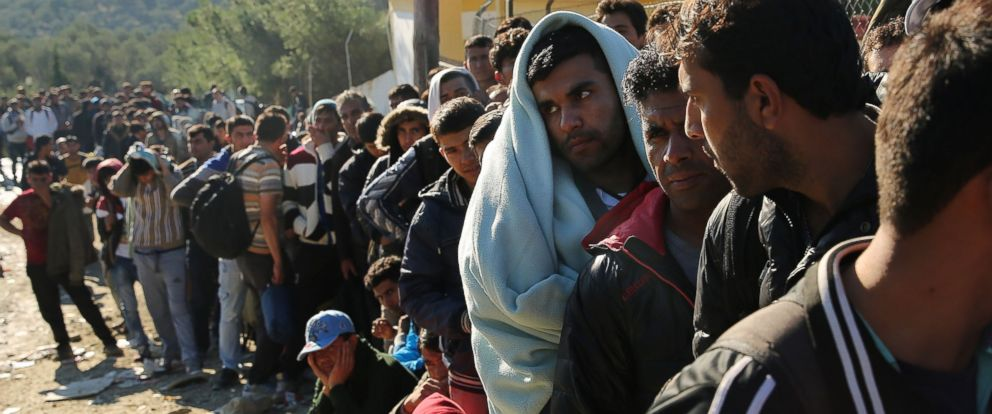 PHOTO: Displaced Syrians, Iraqis and Afghans wait to enter at a reception center on the island of Lesbos on Oct. 14, 2015 in Mitilini, Greece.