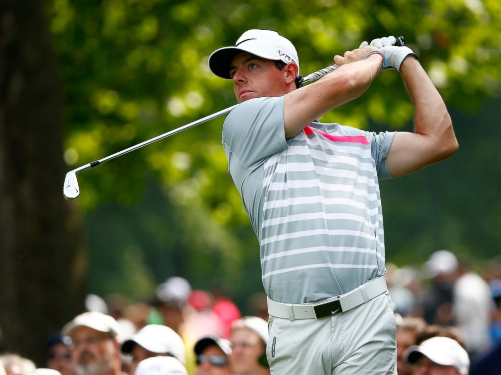 PHOTO: Rory McIlroy of Northern Ireland hits off the fifth tee during the final round of the World Golf Championships-Bridgestone Invitational on August 3, 2014 in Akron, Ohio.