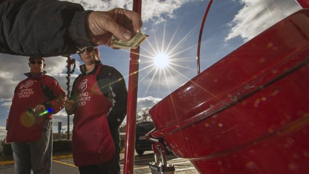 PHOTO: A donation is placed into a Salvation Army kettle in Clifton, Va., in this Nov. 24, 2012 photo.