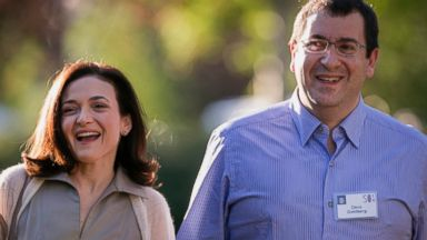 PHOTO: Sheryl Sandberg, COO of Facebook, and her husband David Goldberg, CEO of SurveyMonkey, arrive for morning session of the Allen & Co. annual conference at the Sun Valley Resort in Sun Valley, Idaho, July 9, 2014.