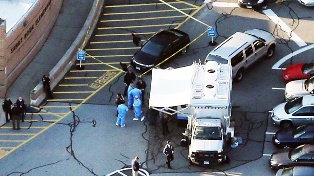 responders gather at the scene of a mass school shooting at sandy hook