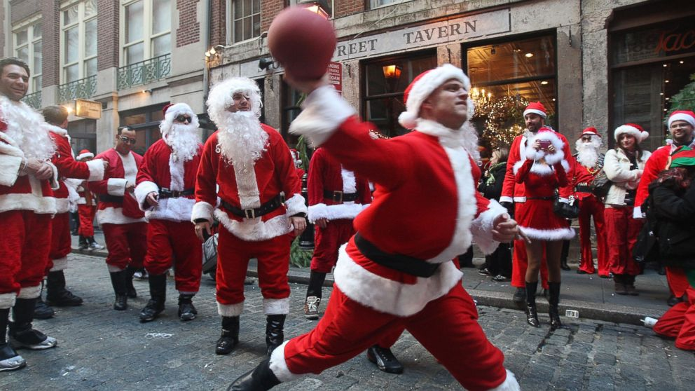 PHOTO: People dressed as Santa Claus celebrate during the annual Santacon event in New York, in this Dec. 12, 2009 photo.